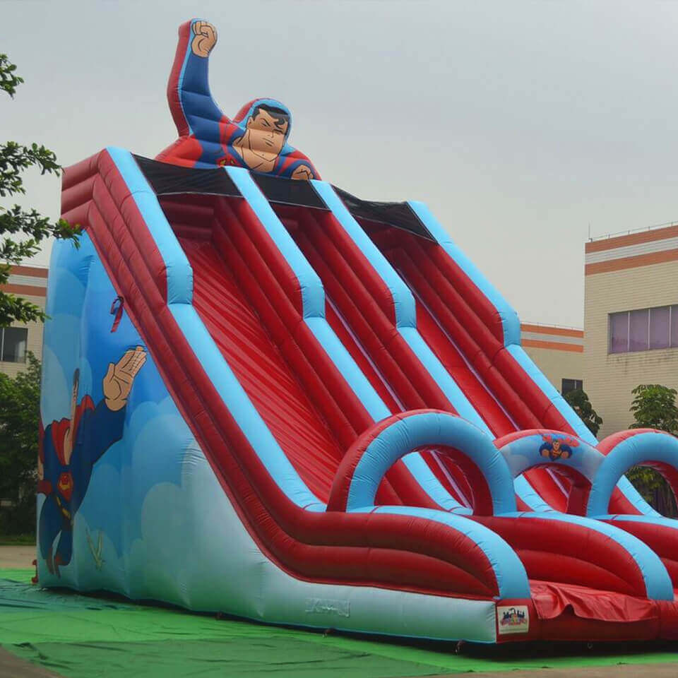 Superman themed inflatable slide
